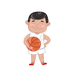 Little boy in basketball uniform holding ball vector