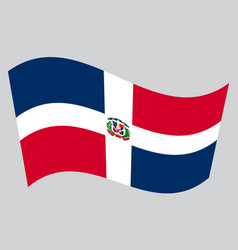 Dominican republic flag waving on gray background vector