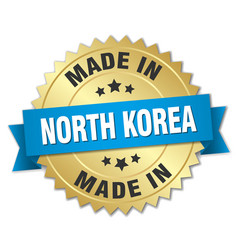 made in north korea gold badge with blue ribbon vector image