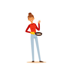 young woman holding frying pan with fried eggs vector image