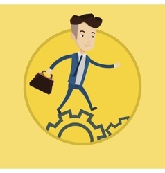 Businessman running on cogwheels vector image