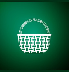 wicker basket icon isolated on green background vector image