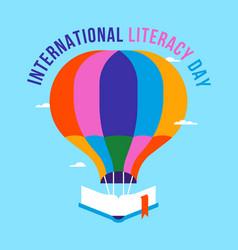 Literacy day open book hot air balloon card vector
