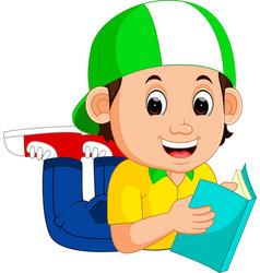 little boy reading a book vector image