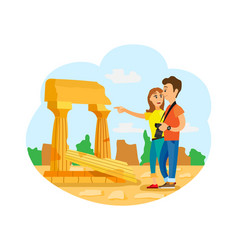 People looking at old ruins pillars and nature vector