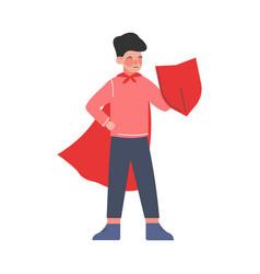 Superhero kid cute brave boy in red cape standing vector