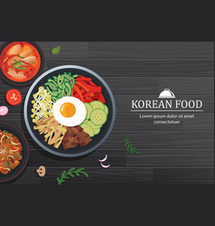 Bibimbap in the bowl on black wood table top view vector