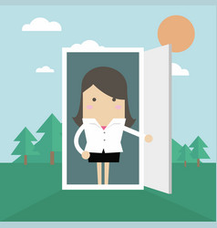 Businesswoman open the door from office to nature vector