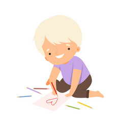 cute blond boy sitting on floor and drawing vector image