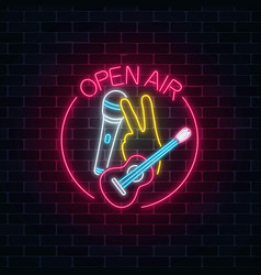 Neon open air sign with microphone guitar and vector