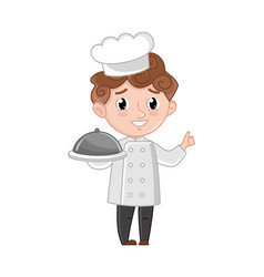 smiling boy in cook uniform with dish vector image