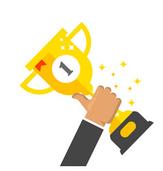 winner award cup - first place prize in hand vector image vector image