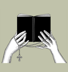hands holding a black book and prayer beads vector image