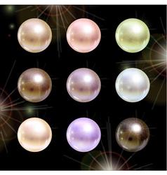 Shinyl pearls on black background set vector image