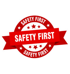 safety first ribbon safety first round red sign vector image