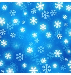 Blue blurred background with glowing snowflakes vector