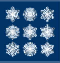white snowflakes silhouettes isolated on dark blue vector image