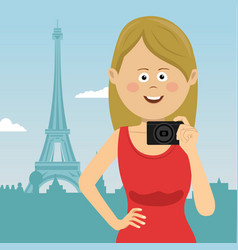 Young tourist woman with film camera in paris vector