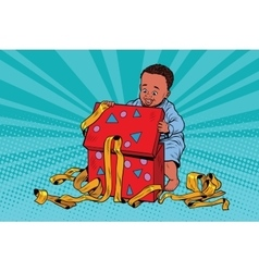 Pop art boy opens the gift box vector image