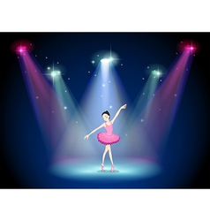 A graceful ballerina at the center of the stage vector