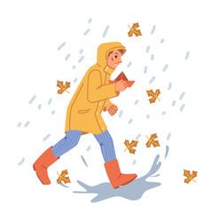 boy kid in raincoat playing under autumn rain vector image