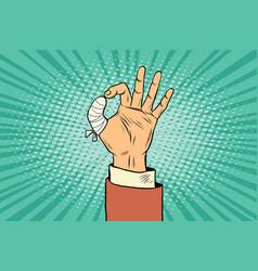 ok gesture bandaged finger vector image