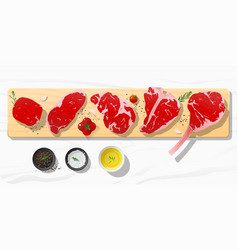 raw beef steaks with seasoning on cutting board vector image
