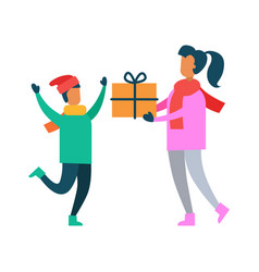 Mother greets son with present packed in gift box vector