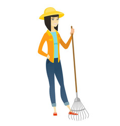 Young asian farmer holding gardening rake vector