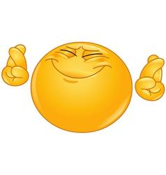crossing fingers emoticon vector image vector image
