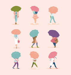 people walking under umbrella in autumn rainy day vector image