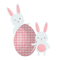 cute rabbits with easter egg painted vector image