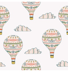 Seamless pattern with hot air balloon and clouds vector