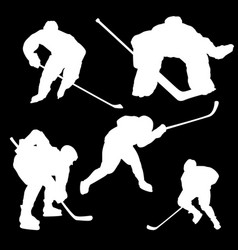 white silhouettes of hockey players on a black vector image