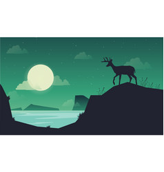 Landscape deer on the hill of silhouettes vector