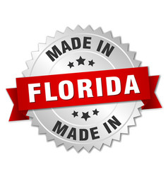 Made in florida silver badge with red ribbon vector