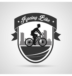 Man riding bike inside shield and ribbon design vector