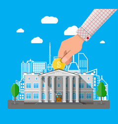 Hand putting coin into bank building vector