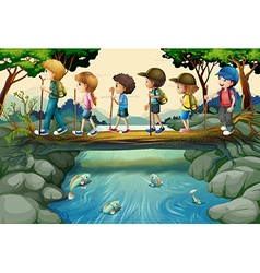 Children hiking in the woods vector image vector image