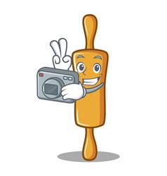 Photographer rolling pin character cartoon vector