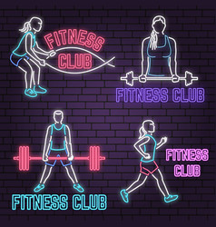 set of neon fitness club sign on brick wall vector image