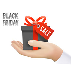 hand holding black friday gift box sale discount vector image vector image