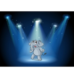 An elephant dancing in the middle of the stage vector image