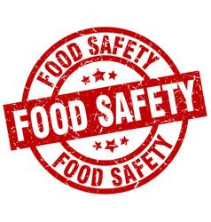 Food safety round red grunge stamp vector