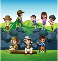 Children hiking and camping in the field vector image