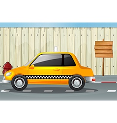 A car a fire hydrant and a notice board vector image