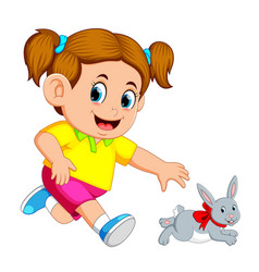 little girl catch up a rabbit vector image