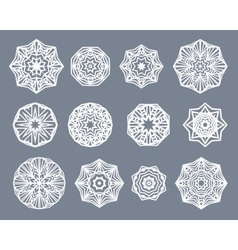 Mandalas set White snowflakes isolated on gray vector image vector image