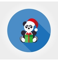 Panda in a santa hat with a gift vector image