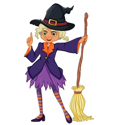 An old witch holding a broomstick vector image